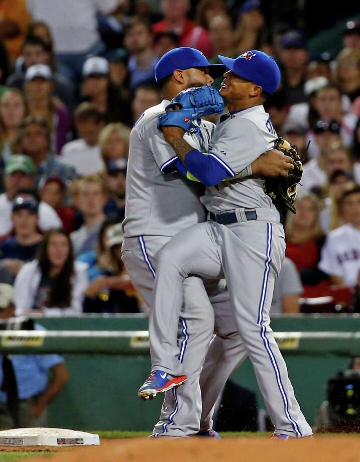 Toronto Blue Jays starting pitcher Marcus Stroman, right, crashes into first baseman Juan Francisco after Francisco decided to tag first base unassisted on a ground out by Boston Red Sox's Stephen Drew in the sixth inning of a baseball game at Fenway Park in Boston, Tuesday, July 29, 2014. (AP Photo/Elise Amendola) ORG XMIT: MAEA109 Photo: Elise Amendola / AP