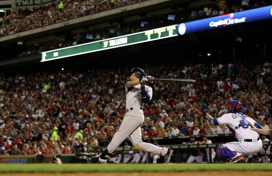 Derek Jeter hits a single in the sixth inning of a baseball game between the New York Yankees and the Texas Rangers Tuesday, July 29, 2014, in Arlington, Texas.  (AP Photo/Ralph Lauer) ORG XMIT: ARL118 Photo: Ralph Lauer / FR52694 AP