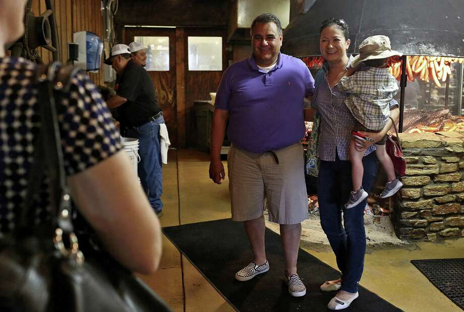 Michael De Leon of Louisville, Ky., poses for a photograph with Cleopatra De Leon, of Austin, and her son. The two, who are among plaintiffs challenging state bans on same-sex marriage, discovered they both hail from Victoria. Photo: Photos By Lisa Krantz / San Antonio Express-News / SAN ANTONIO EXPRESS-NEWS