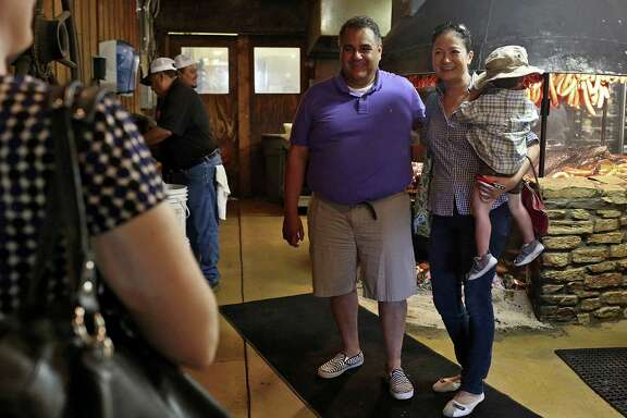 Michael De Leon of Louisville, Ky., poses for a photograph with Cleopatra De Leon, of Austin, and her son. The two, who are among plaintiffs challenging state bans on same-sex marriage, discovered they both hail from Victoria.