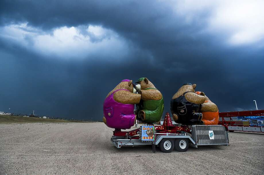 Storm clouds move in over the Larimer County Fairgrounds, Tuesday, July 29, 2014, in Loveland, Colo. (AP Photo/The Coloradoan, Erin Hull) Photo: Erin Hull, Associated Press