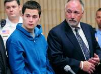 Christopher Plaskon, 17, left, stands with defense attorneys Edward Gavin, left, and Richard T Meehan, Jr., during a hearing in his public court appearance at Superior Court Friday, May 2, 2014, in Milford, Conn. He his charged with the murder of Maren Sanchez, 16, who was stabbed to death on April 25, 2014 inside a hallway at Jonathan Law High School in Milford.
