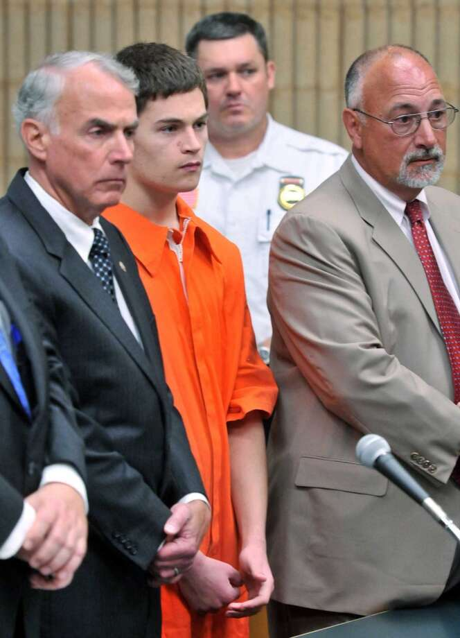Christopher Plaskon, 18, second from left, appears in Superior Court in Milford, Conn., on Wednesday, June 4, 2014. Plaskon, charged with stabbing a classmate to death in school on their prom day, pleaded not guilty to murder Wednesday as his attorney said he was investigating a possible mental health defense. At left is Plaskon's uncle and guardian Paul Healy, and attorney Richard Meehan Jr., stands at right. Photo: Arnold Gold, AP Photo/Arnold Gold, Pool