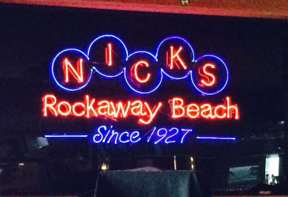 A classic neon sign over the dance floor sets the mood at Nick's Restaurant in Pacifica.