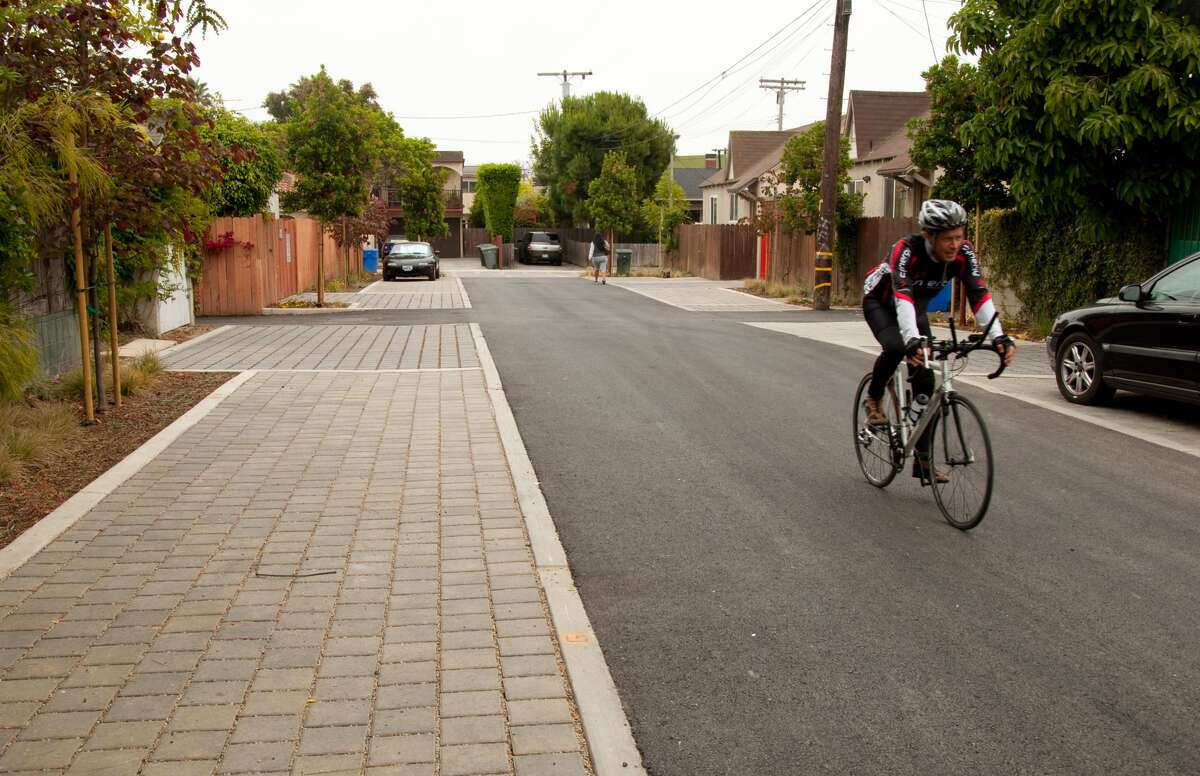 The kind of street that Houston could build: One with landscaping and pavers designed to absorb stormwater; and that's as friendly to bikes and pedestrians as it is to cars. (In Santa Monica, Calif.)