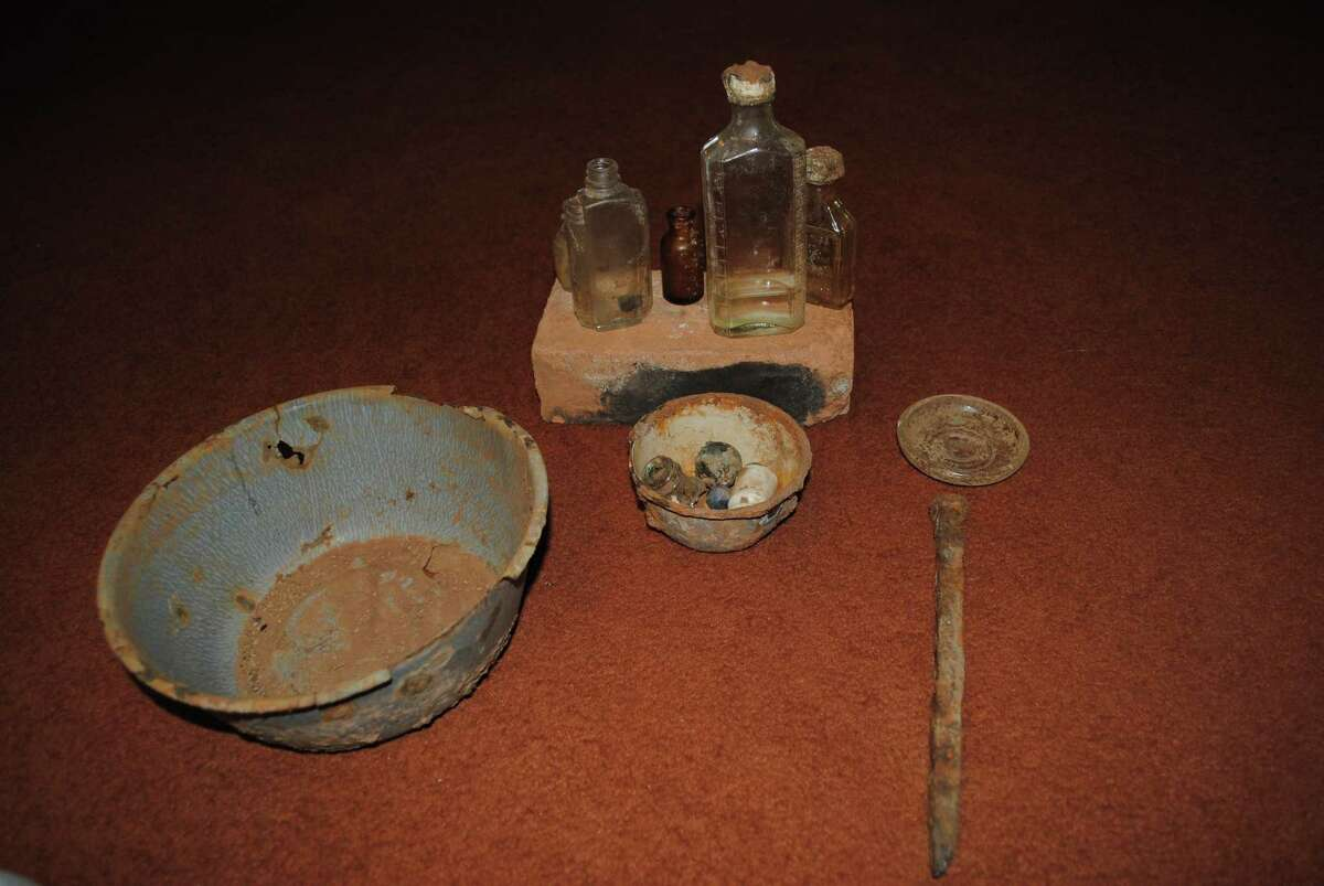 A bowl, brick, railroad spike, marbles, ceramic bits and glass bottles, which all came from the site of Halsell, which is underneath Lake Arrowhead.