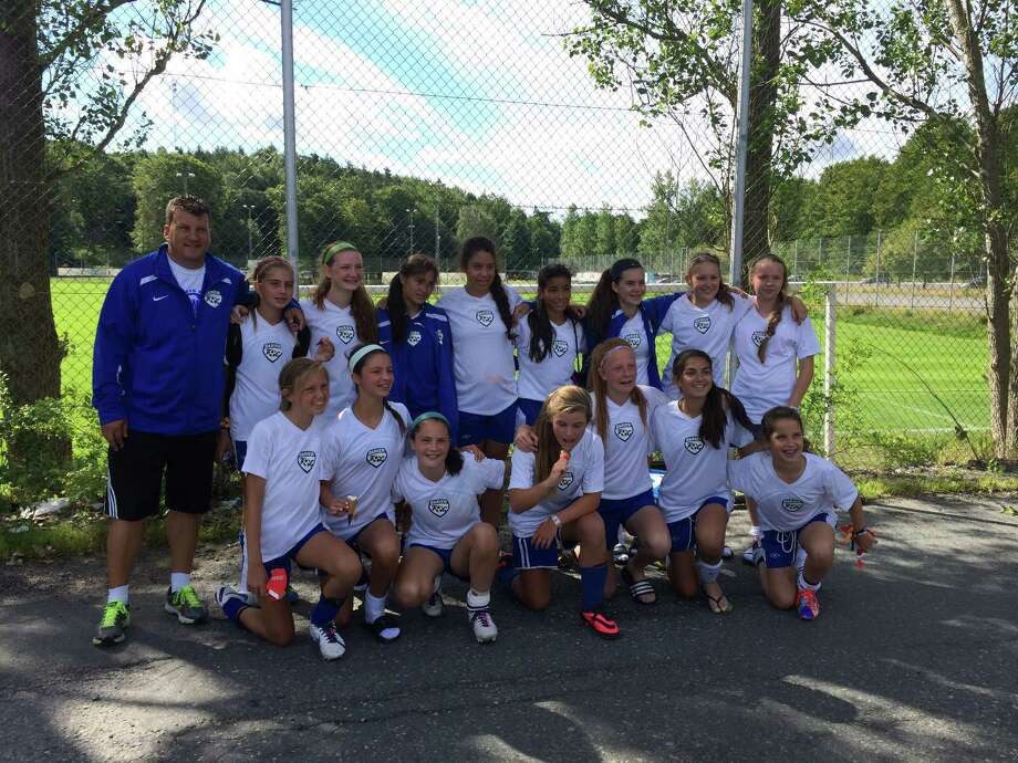 The Darien FC 14U girls team poses after its final game in the Gothia Cup on Thursday, July 17 in Gothenberg, Sweden. From left in the top row, coach Jon Bradley, Bridget Salmini, Corrine Bevill, Maria Eliazethe, Francesca Macdonald, Fabiana Bueno, Ali Quirk, Lena Stroem, Saffron Rafter, Marley Garfield, Olivia de Gulis, Sarah Logan, Ella Murphy, Darcey Edwards, Ellie de Souza and Eilanna Dolan. Photo: Contributed / Darien News Contributed
