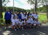 The Darien FC 14U girls team poses after its final game in the Gothia Cup on Thursday, July 17 in Gothenberg, Sweden. From left in the top row, coach Jon Bradley, Bridget Salmini, Corrine Bevill, Maria Eliazethe, Francesca Macdonald, Fabiana Bueno, Ali Quirk, Lena Stroem, Saffron Rafter, Marley Garfield, Olivia de Gulis, Sarah Logan, Ella Murphy, Darcey Edwards, Ellie de Souza and Eilanna Dolan.