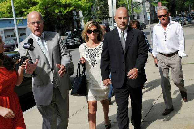 Troy Police Officer Brian Gross, center, walks with attorney Steve Coffey, left, to face evidence tampering charges on Wednesday, July 30, 2014, at City Court in Troy, N.Y. (Cindy Schultz / Times Union) Photo: Cindy Schultz