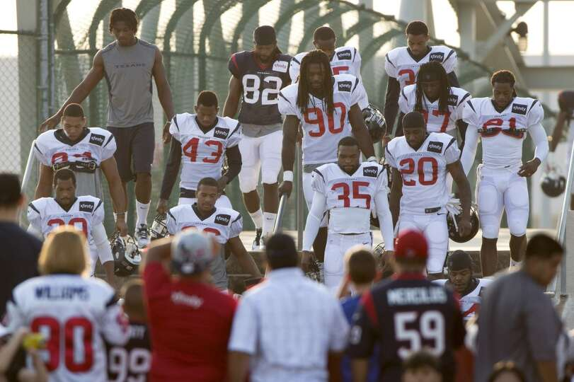Day 5: July 30   Texans fans watch as Texans players walk to the pr