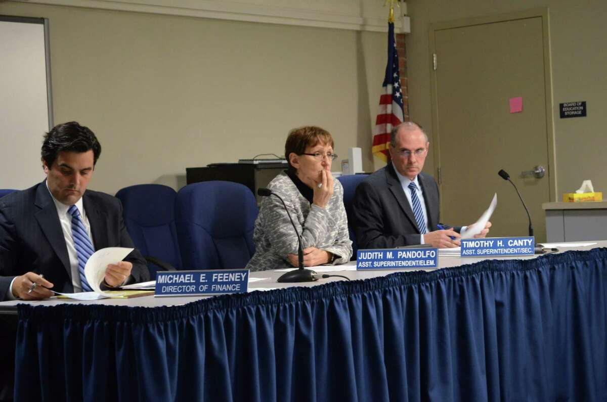 Judith Pandolfo, former assistant superintendent of elementary education, center, will retire from Darien Public Schools, effective June 30, 2015. At a recent public meeting, she was flanked by Director of Finance Mike Feeney, left, and Tim Canty, right, now the assistant superintendent of K-12 curriculum.