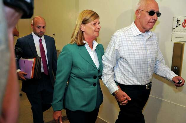 Jackie Gentile, center, Chief Operating Officer for Peter Young, leaves the courthouse following her arraignment on Wednesday, July 30, 2014, in Schenectady, N.Y.  (Paul Buckowski / Times Union) Photo: Paul Buckowski / 00027991A