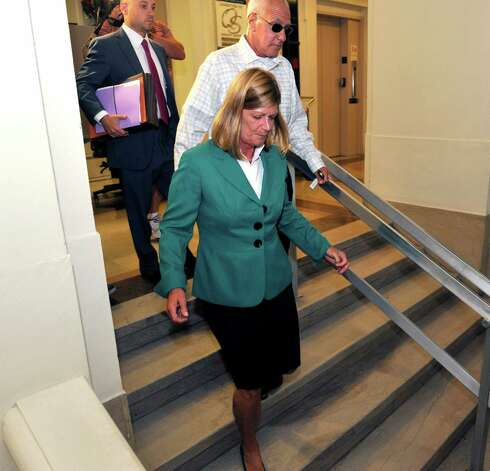 Jackie Gentile, Chief Operating Officer for Peter Young, leaves the courthouse following her arraignment on Wednesday, July 30, 2014, in Schenectady, N.Y.  (Paul Buckowski / Times Union) Photo: Paul Buckowski / 00027991A