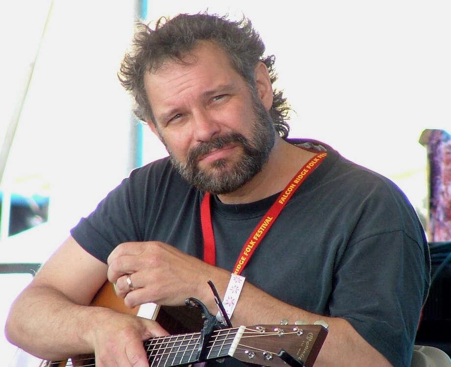 John Gorka on stage at Falcon Ridge Folk Festival 2004. Photo: Marion Schorr .