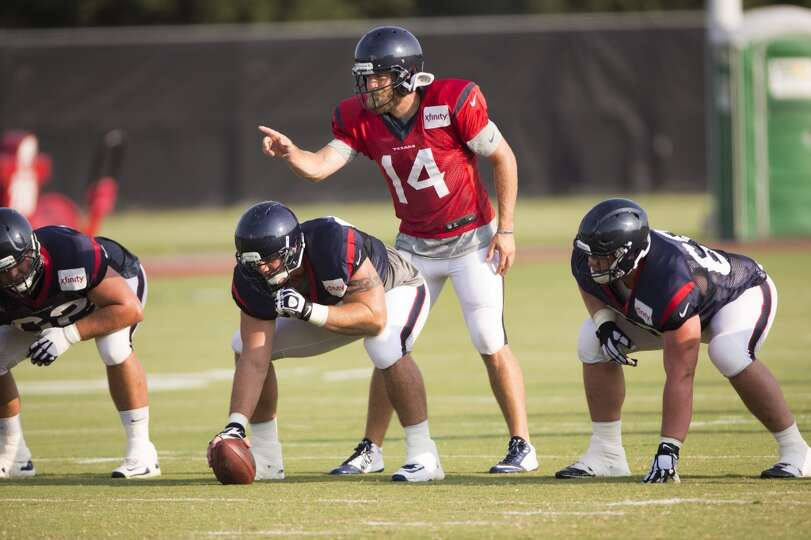 Texans quarterback Ryan Fitzpatrick (14) calls a play as he lines up behind center Chris Myers (55)