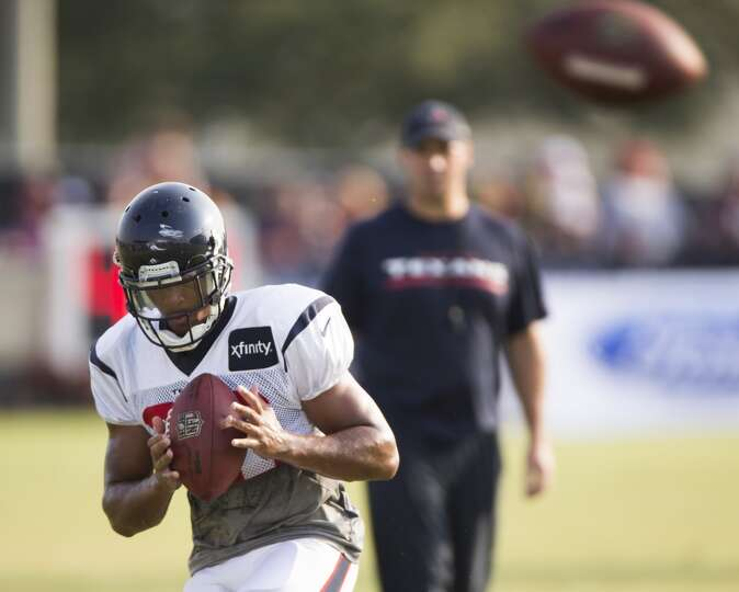 Texans defensive back Brandon Harris returns a football during Texans training camp.