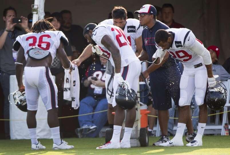 Texans defensive backs D.J. Swearinger (36), Chris Clemons (20), Shiloh Keo (31) and Jawanza Starlin