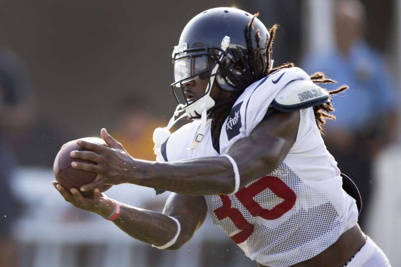 Texans strong safety D.J. Swearinger reaches out to catch a pass.