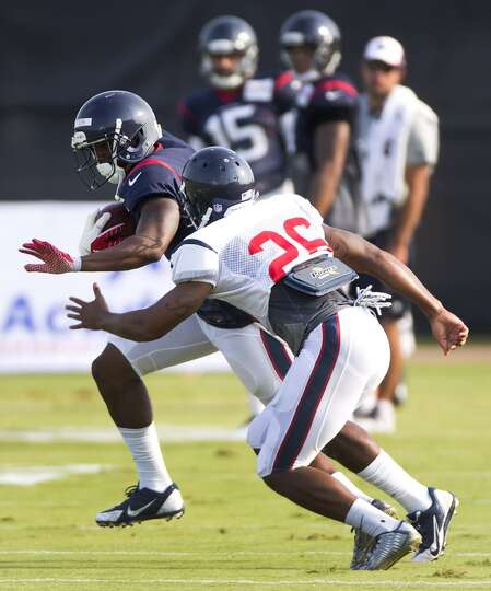 Texans wide receiver Lacoltan Bester runs upfield after making a catch against defensive back Brando