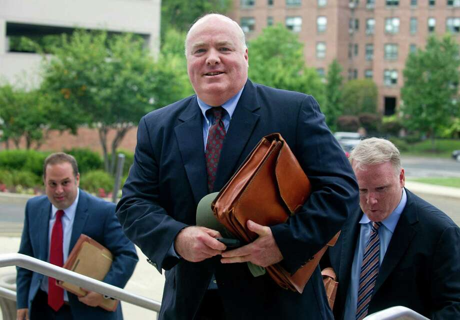 Michael Skakel, right, arrives at State Superior Court in Stamford, Conn., on Wednesday, July 30, 2014, with his attorney, Stephan Seeger, right. Photo: Lindsay Perry / Stamford Advocate