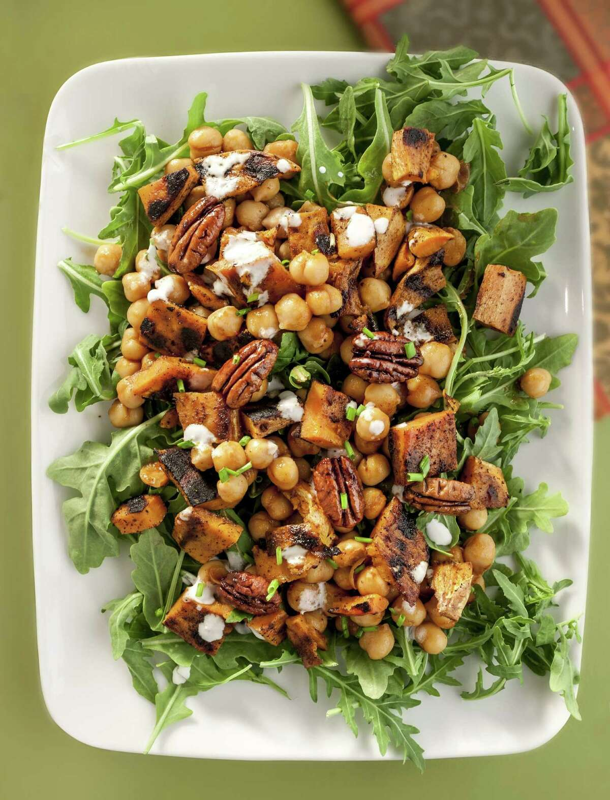 Featured here, barbecue sweet potato with arugula and pecans. (Bill Hogan/Chicago Tribune/MCT)