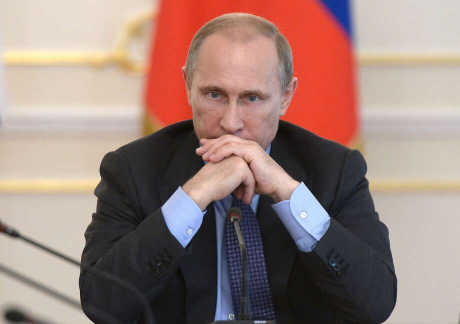 Vladimir Putin chairs a meeting at his residence outside Moscow. Photo: Alexei Nikolsky, AFP/Getty Images