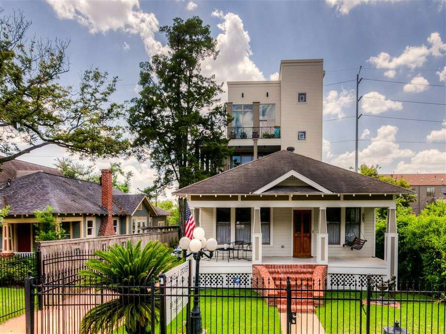 This amazing 4-story Heights home comes with a bonus property out front. Photo: Houston Association Of Realtors