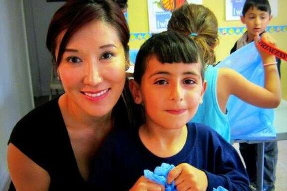 """Mandy Kao at a """"Summer Slide"""" home-library giveaway."""
