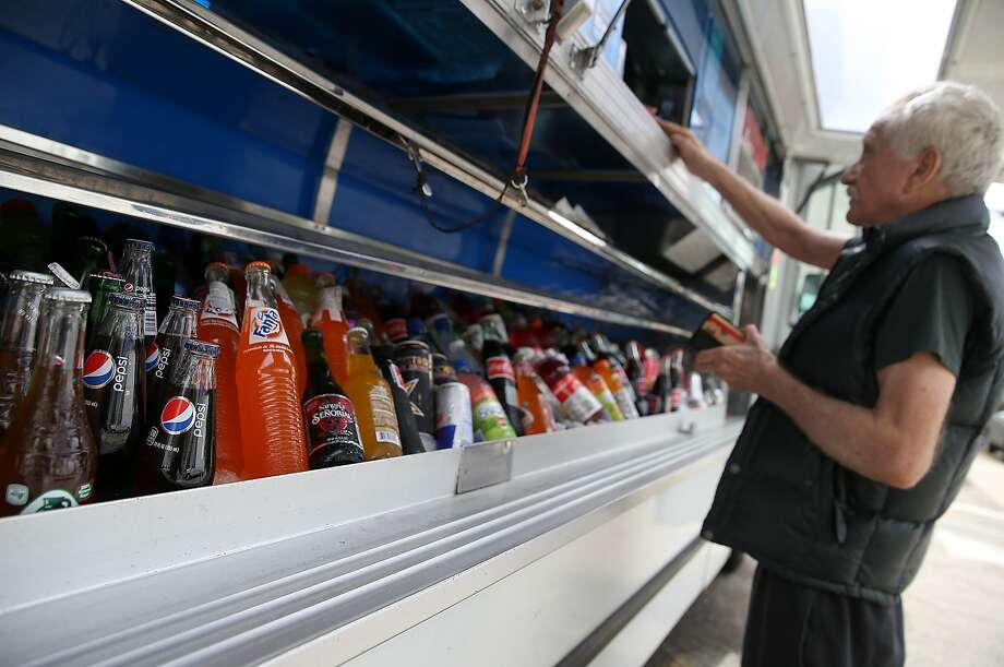 SAN FRANCISCO, CA - JULY 22:  Various sottles of soda are displayed in a food truck's cooler on July 22, 2014 in San Francisco, California. The San Francisco Board of Supervisors will vote on Tuesday to place a measure on the November ballot for a 2-cents-per-ounce soda tax. If the measure passes in the November election, tax proceeds would help finance nutrition, health, disease prevention and recreation programs.  (Photo by Justin Sullivan/Getty Images) Photo: Justin Sullivan, Getty Images