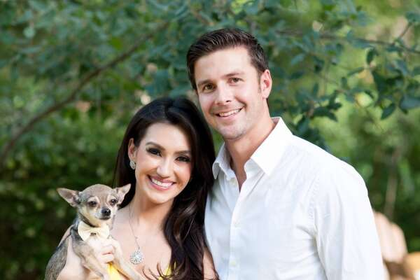 The proud  parents: Isis Romero of KSAT and KENS-TV's Phil Anaya (with dog Louis) are now married.