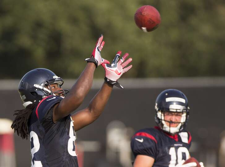Texans wide receiver Keshawn Martin (82) reaches out to catch a pass.