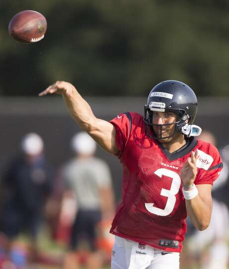 Texans quarterback Tom Savage throws a pass.