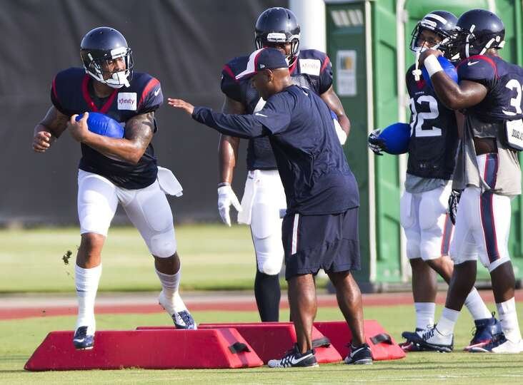 Texans running back Arian Foster (23) runs a drill.