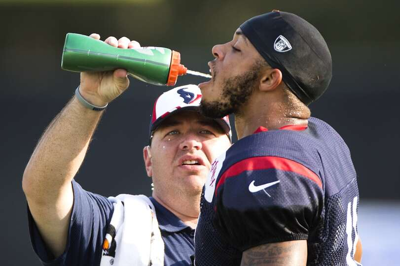 Texans wide receiver DeVier Posey (11) gets a drink of water.