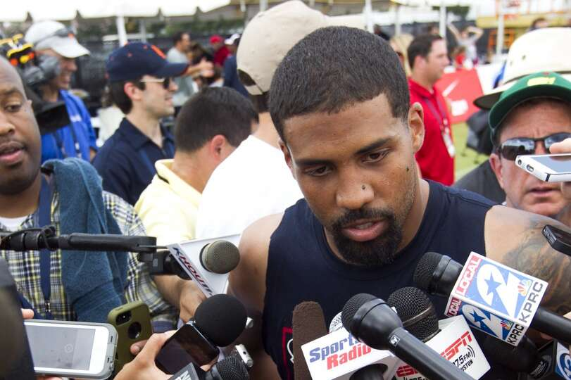 Houston Texans running back Arian Foster talks to the media during Texans training camp at the Metho