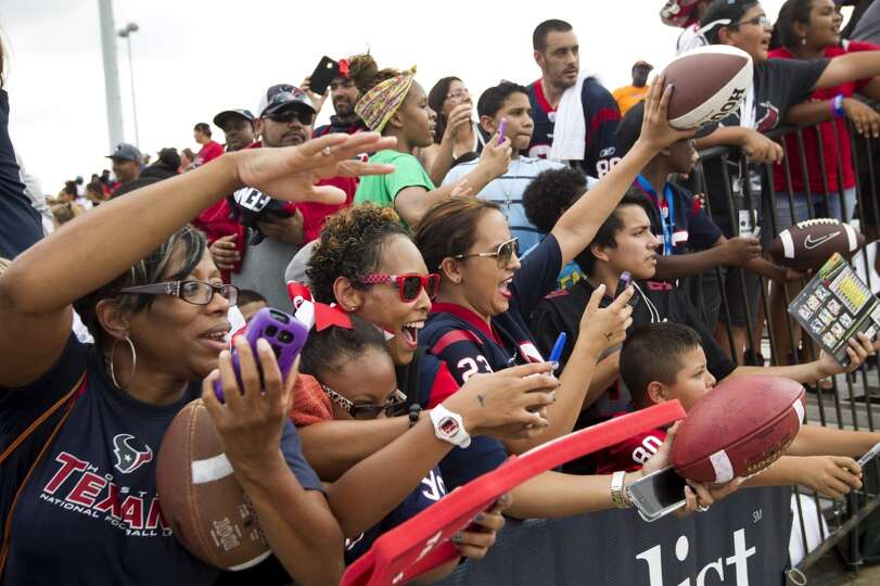 Houston Texans fans seek autographs during Texans training camp at the Methodist Training Center Wed