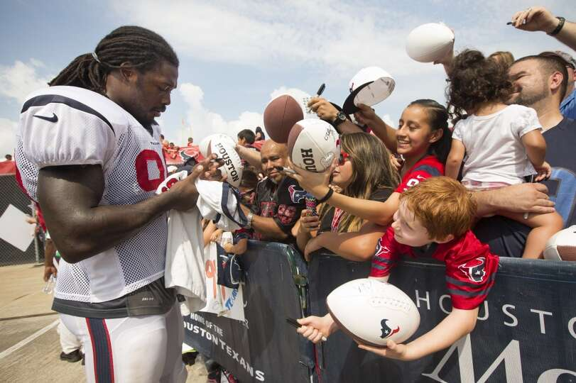 Houston Texans linebacker Jadeveon Clowney (90) signs autographs during Texans training camp at the