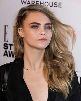 Model/actress Cara Delevigne  Note: Alleged photos were reportedly released Friday, Sept. 26 on 4chan/Reddit. The star has made no comment. Photo: Mark Cuthbert, Contributor / 2014 Mark Cuthbert