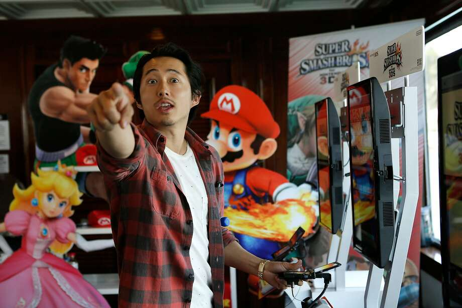 Actor Steven Yeun spends time in the Nintendo Lounge on the TV Guide yacht at Comic-Con. Photo: Mike Windle, (Credit Too Long, See Caption)