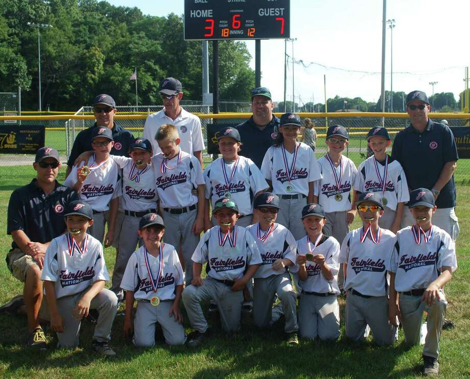Members of the Fairfield National Little League tournament team of 10 year olds, which won the Seabreeze Tournament in Orange on July 20, along with its manager and coaches. Photo: Contributed Photo / Fairfield Citizen