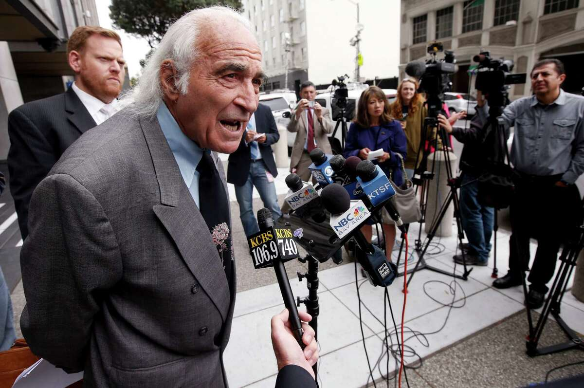 Attorneys Tony Serra and Curtis Briggs (left) speak to the media after their client Raymond