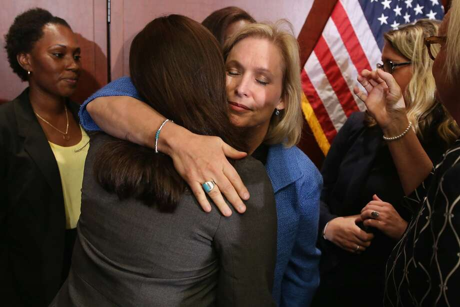 WASHINGTON, DC - JULY 30:  Sen. Kristen Gillibrand (D-NY) embraces End Rape on Campus co-founder Andrea Pino, a survivor of sexual assult at the University of North Carolina, during a news conference about new legislation aimed at curbing sexual assults on college and university campuses at the U.S. Capitol Visitors Center July 30, 2014 in Washington, DC. With strong bipartisan support in the Senate, the bill would require schools to make public the result of anonymous surveys about campus assaults and impose significant financial burdens on universities that fail to comply with some of the law's requirements.  (Photo by Chip Somodevilla/Getty Images) *** BESTPIX *** Photo: Chip Somodevilla, Getty Images