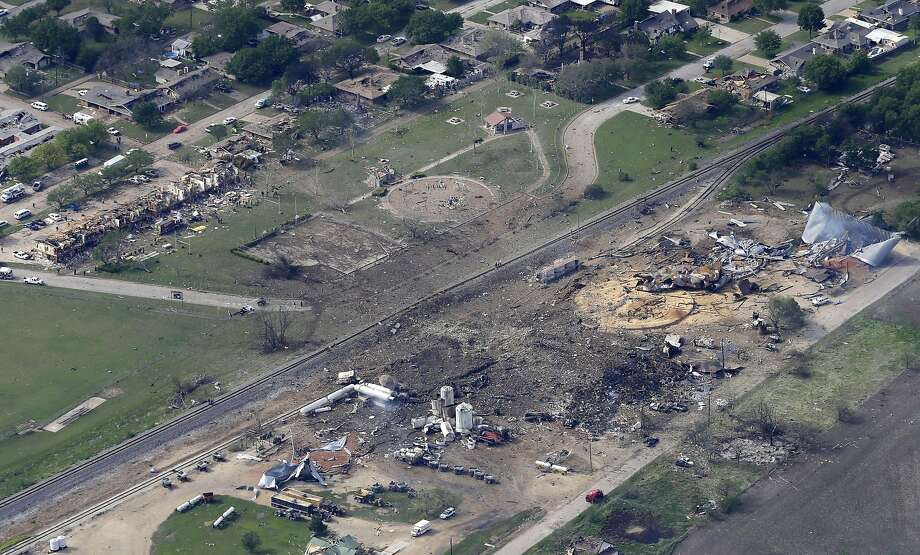 This April 18, 2013 file photo shows an aerial view of the remains of a fertilizer plant and an apartment complex to the left, destroyed by an explosion in West, Texas.  The government has failed to inspect virtually all of the chemical facilities that it considers to be at high risk for a terror attack, numbering in the thousands, and has underestimated the threat to densely populated cities, congressional investigators say.  (AP Photo/Tony Gutierrez, File) Photo: Tony Gutierrez, Associated Press
