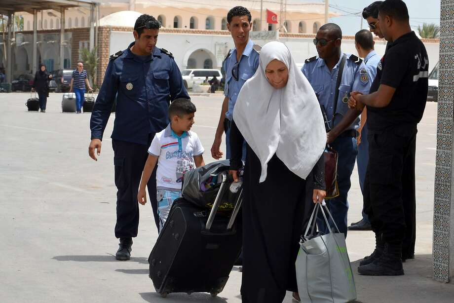 A Libyan woman fleeing militia violence enters Tunisia through the southern border crossing at Ras Jedir. Tunisia says it cannot cope with an influx of refugees and may close its borders. Photo: F Nasri, AFP/Getty Images