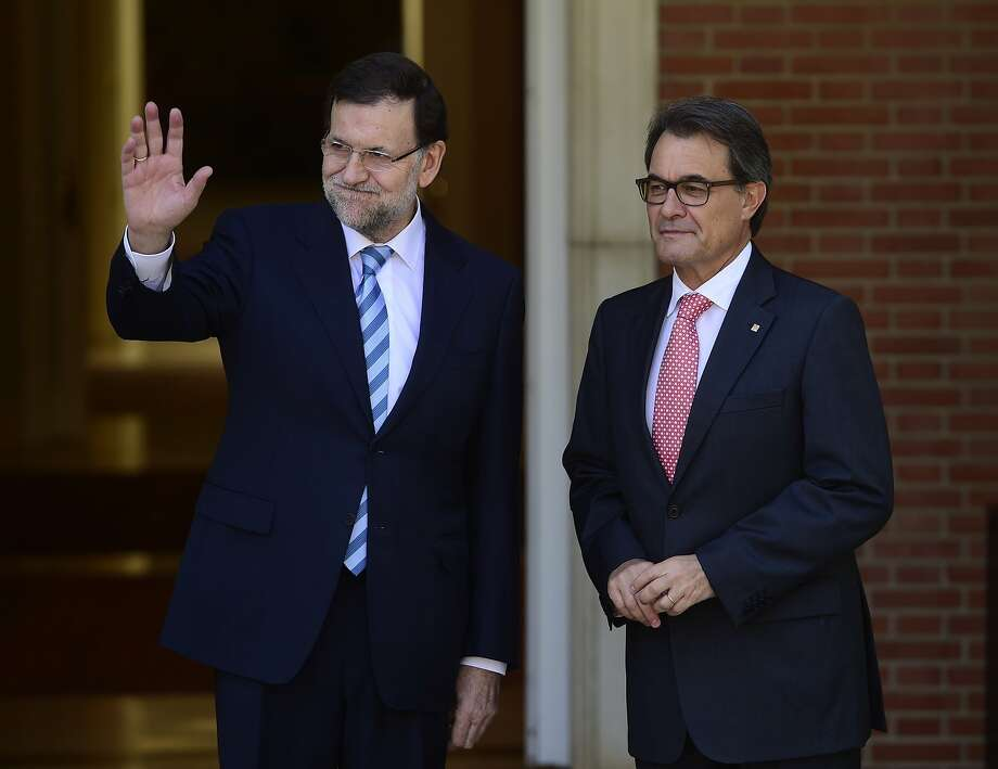 "Spanish Prime Minister Mariano Rajoy (L) and president of Catalonia's regional government Artur Mas pose before a meeting at the Moncloa place in Madrid on July 30, 2014. Rajoy recently recognized a ""problem"" between the central government and Catalonia, which accounts for 20% of Spain's wealth, with the situation being totally blocked for two years and the region experiencing a strong push for independence. The region intends to organize a referendum on self-determination on November 9, despite fierce opposition from Madrid.  AFP PHOTO / PIERRE-PHILIPPE MARCOUPIERRE-PHILIPPE MARCOU/AFP/Getty Images Photo: Pierre-philippe Marcou, AFP/Getty Images"