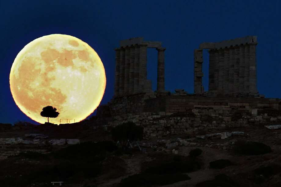 Scientists say the moon is slightly lemon-shaped rather than a true sphere. Photo: Aris Messinis, AFP/Getty Images