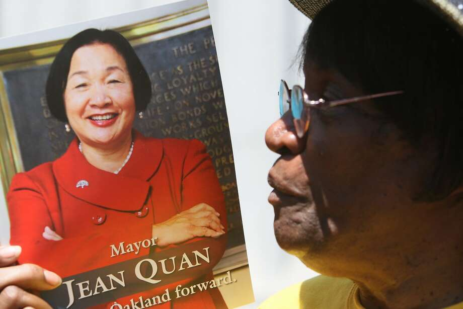 Supporter Rosie Bonds holds a sign in support of Oakland Mayor Jean Quan on the steps of Oakland City Hall after Quan  filed her official re-election nomination papers with the City Clerk's office. Photo: Craig Hudson, The Chronicle