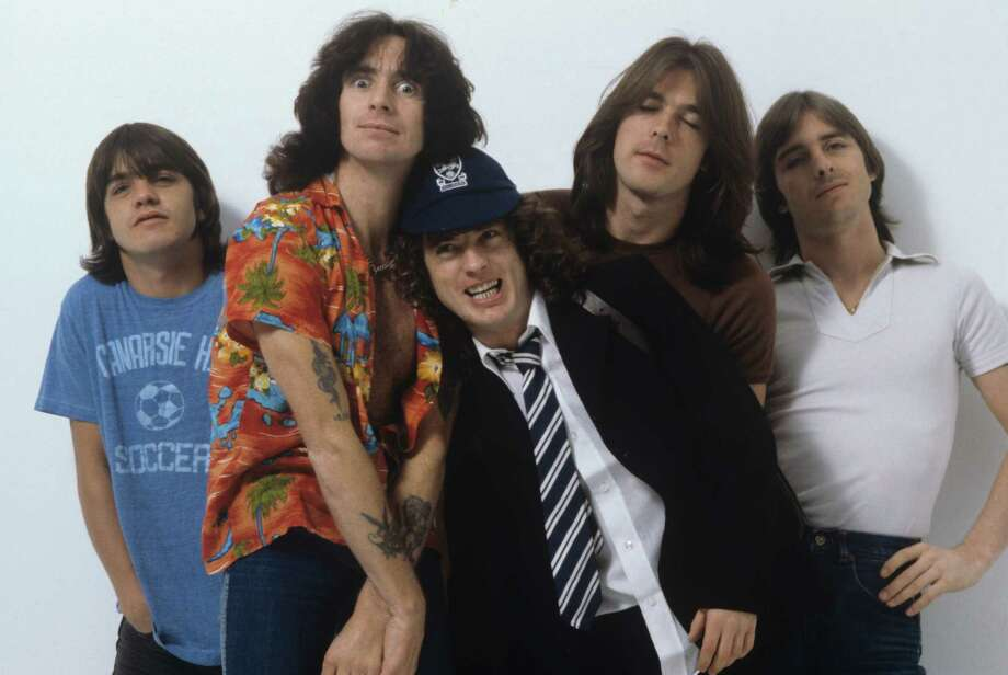 LONDON, UNITED KINGDOM - AUGUST 01: (left to right) Malcolm Young, Bon Scott, Angus Young, Cliff Williams and Phil Rudd of Australian rock band AC/DC pose in London, England in August 1979. Photo: Fin Costello, Redferns / 1979 Fin Costello