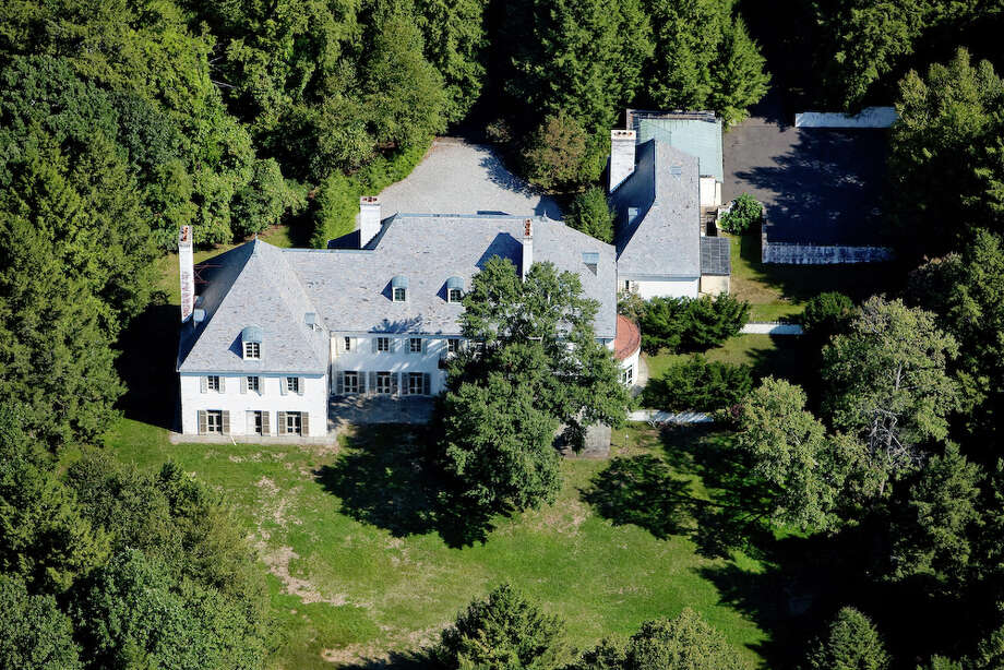 FILE - Above, an August 2010 file photo, provided by Barbara Cleary's Realty Guild, shows the New Caanan estate of Huguette Clark, a copper magnate from Montana. The property, which had been subdivided into 10 parcels in 2008, was merged back into one lot this week, following approval by the Planning and Zoning Commission. (AP Photo/Barbara Cleary's Realty Guild, File) Photo: Uncredited, Associated Press / Associated Press