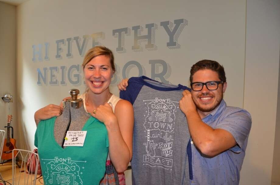Marcella Kovac and Jordan Rabidou show off new t-shirts designed by The Bananaland and printed by Paradox Ink (both Bridgeport-based businesses) during the Startup Roadshow on Tuesday, July 29 hosted by The Whiteboard and B:Hive Bridgeport. Photo: City Of Bridgeport